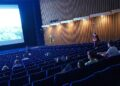 BERLIN, GERMANY - JULY 02: People arrive to watch a late night film at Kino International on the first day that cinemas reopened in Berlin during the novel coronavirus pandemic on July 02, 2020 in Berlin, Germany. Germany is continuing to lift lockdown restrictions nationwide while at the same time remaining wary of possible further outbreaks. (Photo by Sean Gallup/Getty Images)